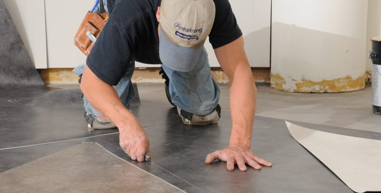Flooring contractor installing Armstrong Flooring